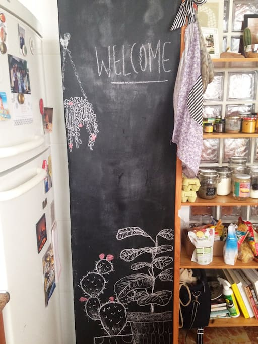 in our kitchen we have a fun chalk wall, feel free to get creative. Chalk is above the fridge.