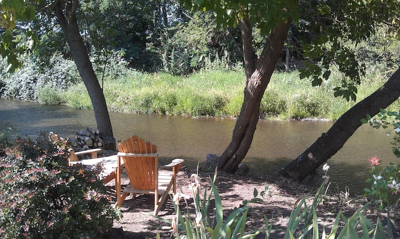 Enjoy your morning coffee or evening glass of wine by the river in the back yard.