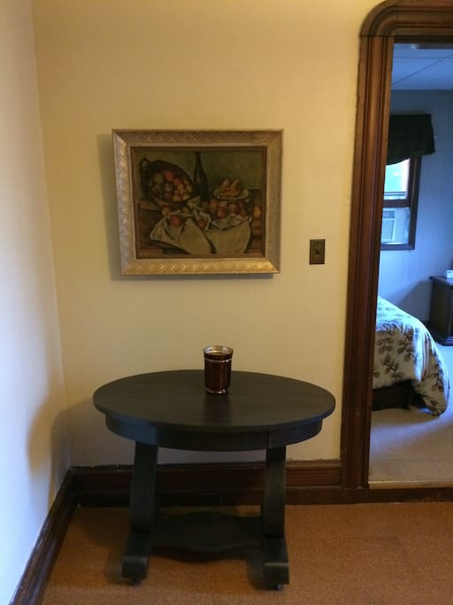 Small side table in dining room...bedroom up to the right.