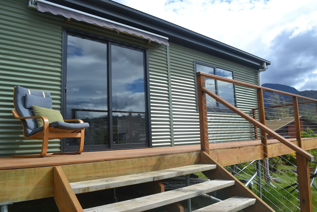 Sunny backyard cabin self contained cottages for rent for Self contained cabin