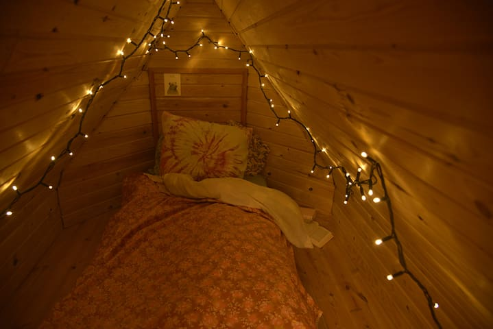 Room with  a cozy attic.