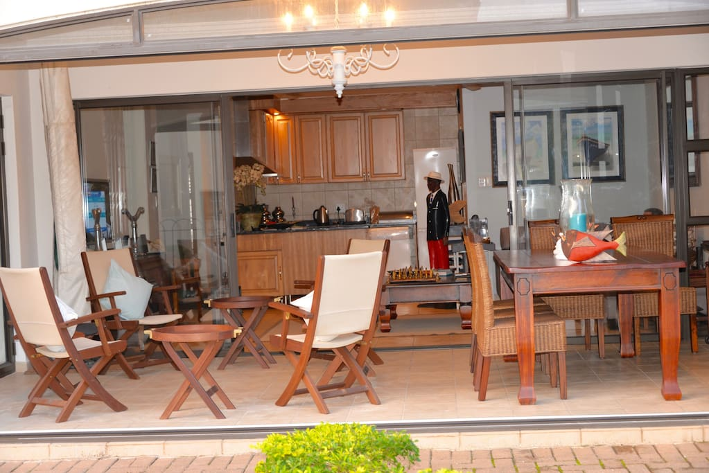 Comfortable patio with fold back glass doors
