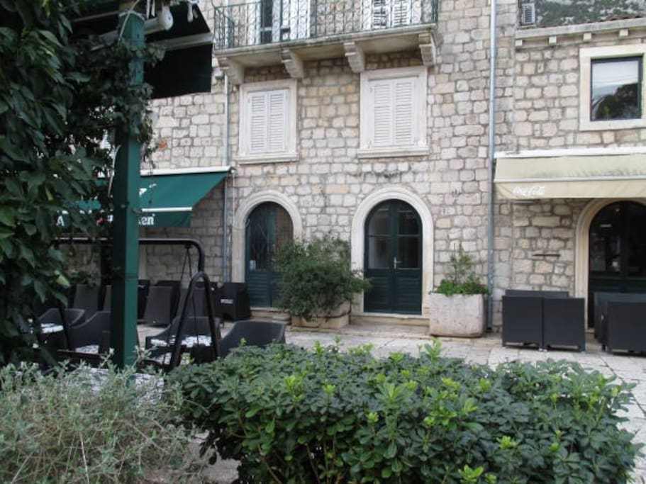 Main street Placa in Ston (our apartment is on a 2nd floor, 2 white windows, entrance is one to the right), just 2 min walking from bank, grocery store, market, post office, bakery, bus stop, bars and restaurants!