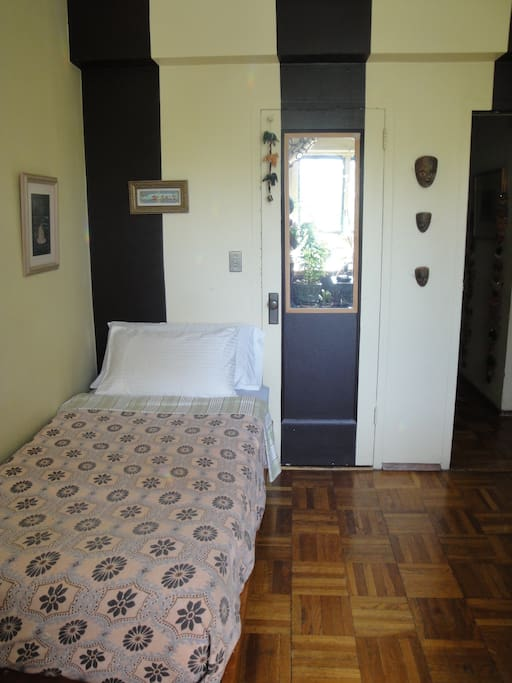Sunny private room with single bed.