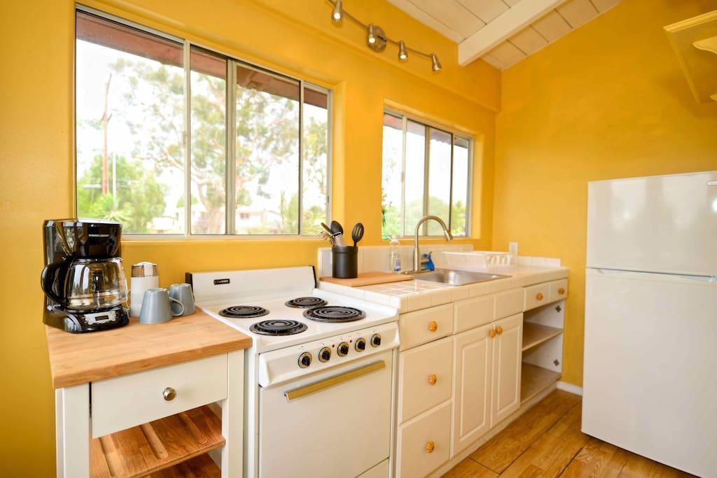 Full size fridge, range, coffee maker and mircrowave (not shown)