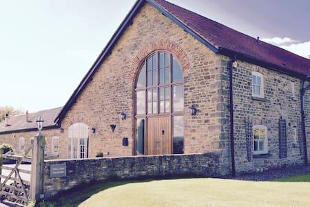 Luxurious barn - sleeps 12. Stunning location.