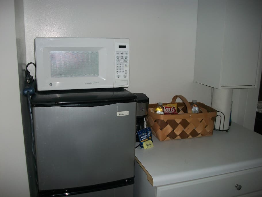 Small fridge & microwave in room alcove