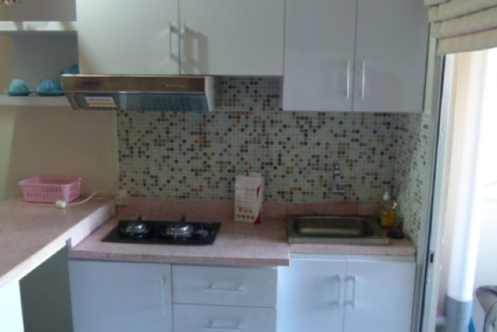 Kitchen, gas stove , glass, dishes etc