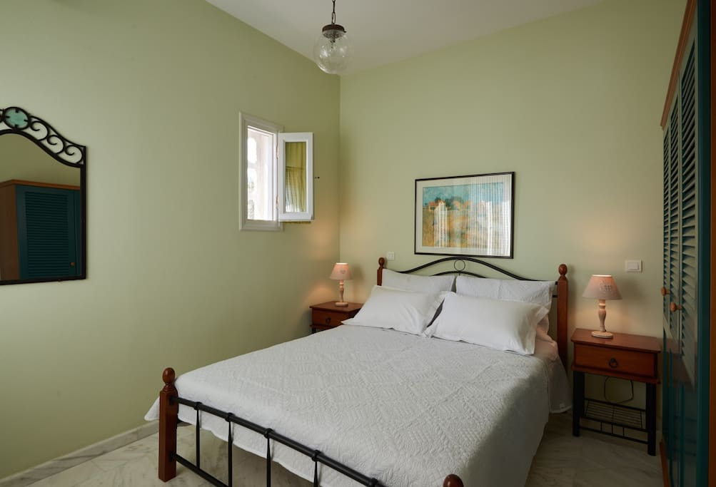 one of the three bedrooms of Marble White