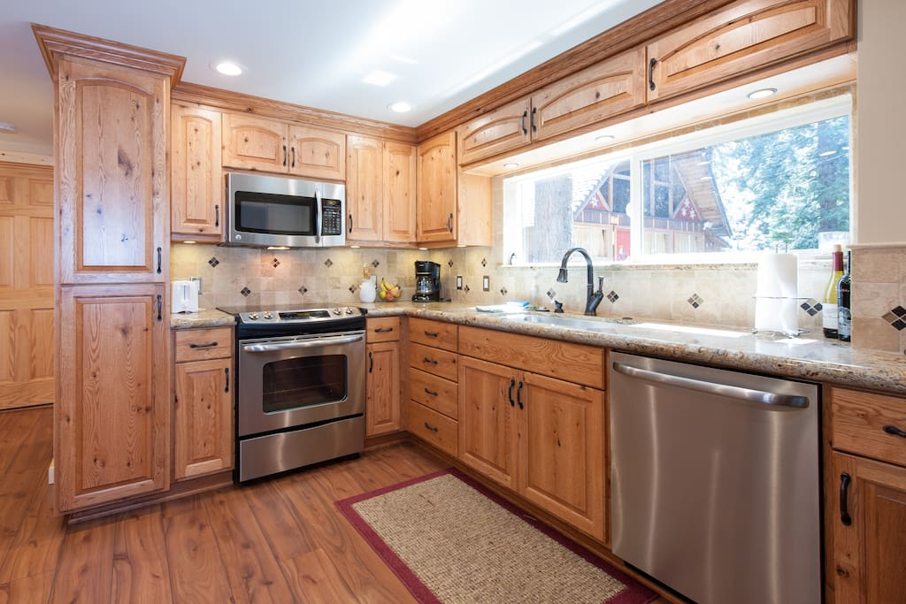Kitchen with oven, microwave, dishwasher and refrigerator (not shown)