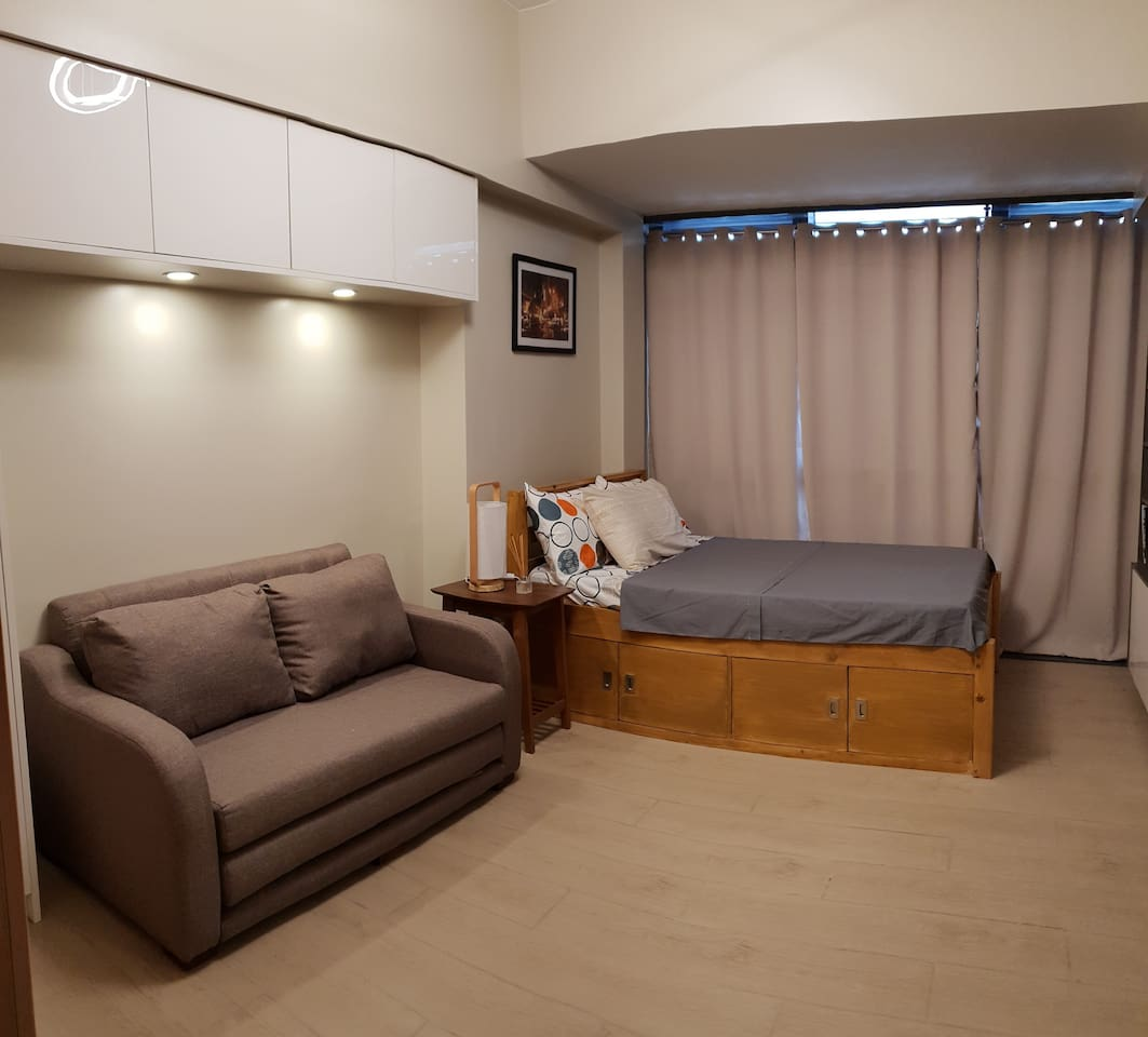 Stay here after a long day of shopping or just chill out with friends and family. Spacious condo unit walking distance from Eastwood City Mall.