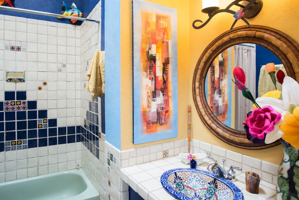 Sink, tiles, and fish (on walls) are direct from Mexico