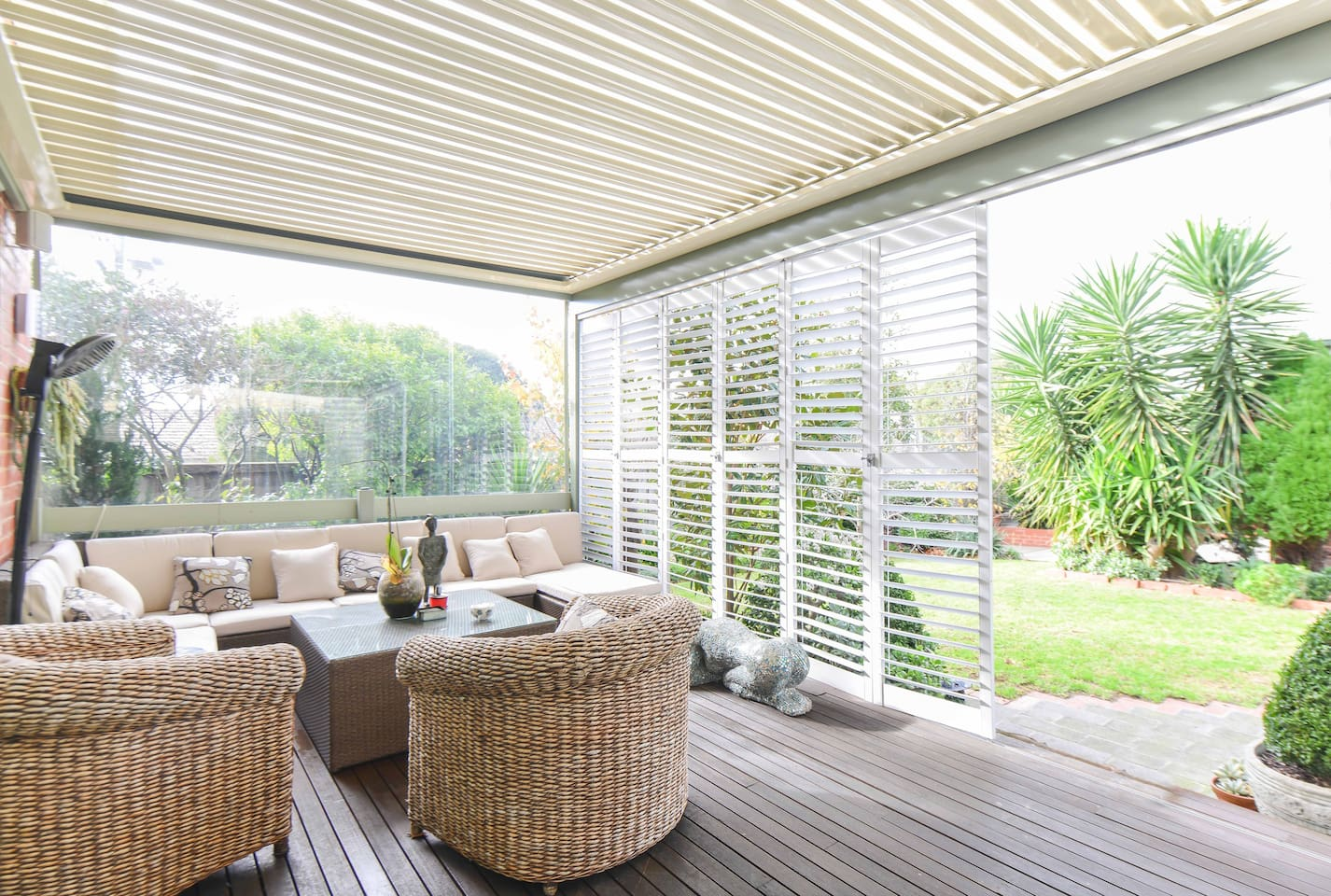 Outdoor entertaining area with vergola roof that closes automatically if it starts raining. Can be fully enclosed to create yet another entertaining area.