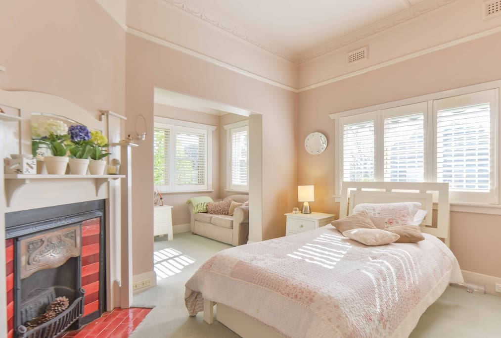 This is bedroom no. 2 which has its own study room attached, wardrobes and own full sized bathroom close by. It's a lovely bright room looking out into the garden.