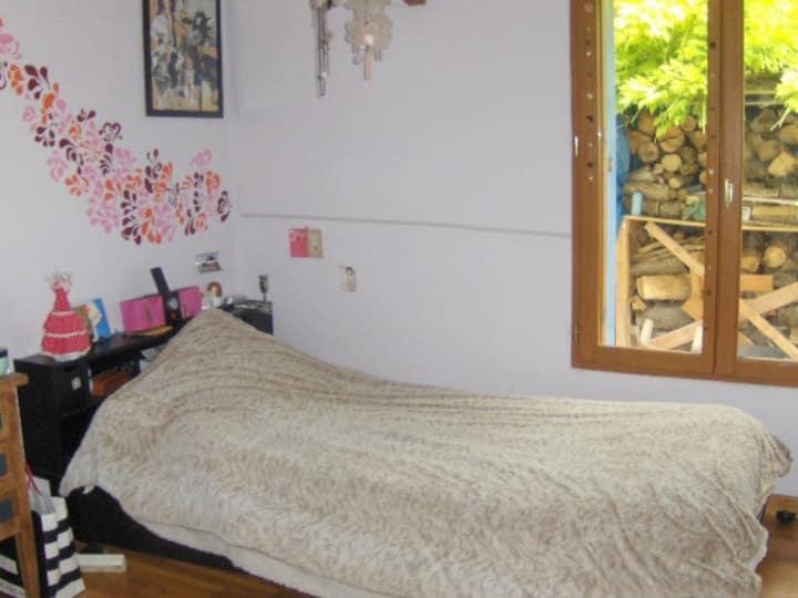 Jolie chambre dans une maison