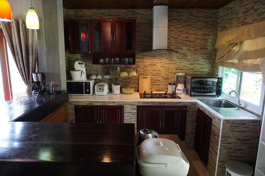 Kitchen. There is a coffee machine, blender, juicer, electronic cooker, oven, microwave. We have even a popcorn machine. For comfortable cooking on gas, we have extractor hood.