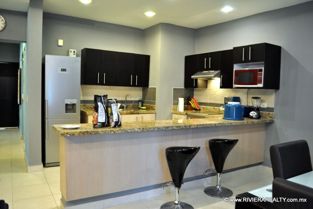 Fully equipped granite counter-top kitchen.
