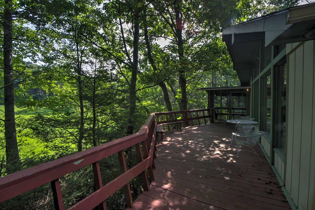 Lounge on the wrap-around deck while admiring the forest and mountain views.