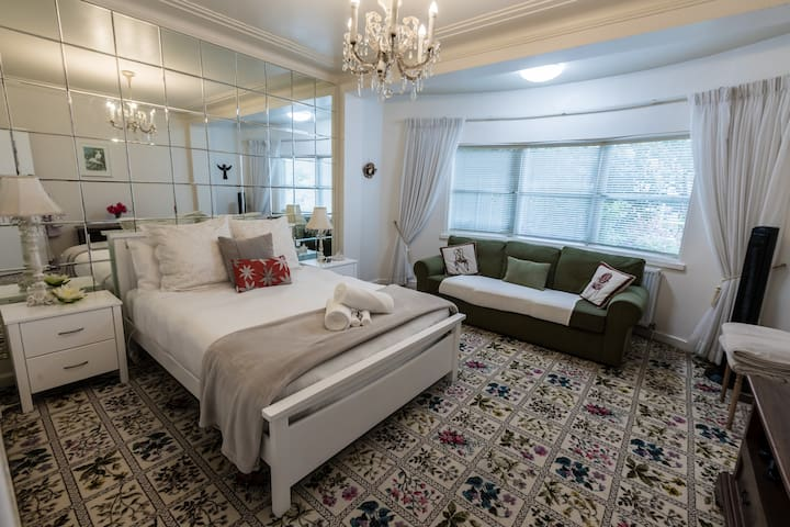 Spacious Queen bedroom with 3 seater lounge
