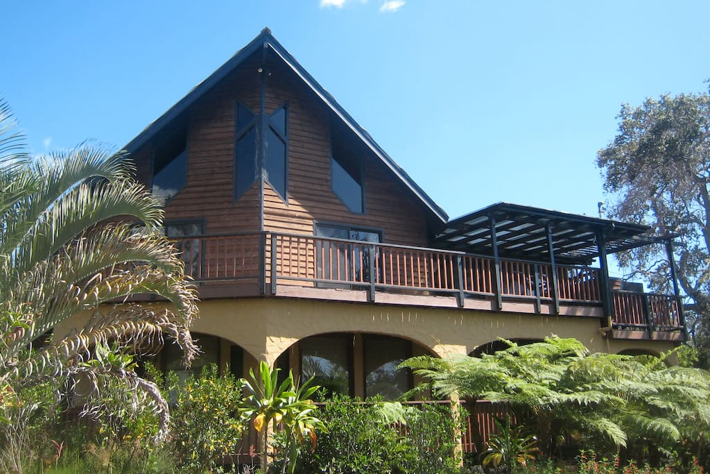 Deck up stairs and Lanai area dowstairs. Separate master bedroom is on the second floor.