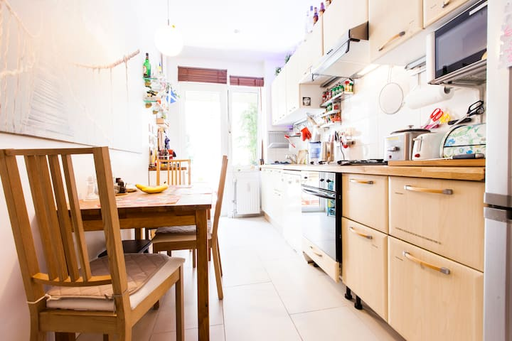 fully equipped kitchen and dining room, with access to a cute balcony