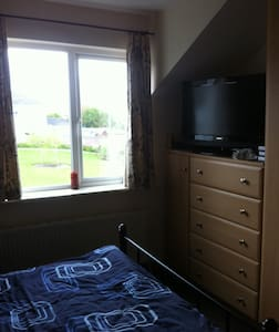 We live in a quiet residential area 4.5km from city centre. We are 3km from Salthill holiday resort. There is a direct bus to City centre, NUIG, Salthill etc. We are pretty flexible about most everything. Please read our reviews.