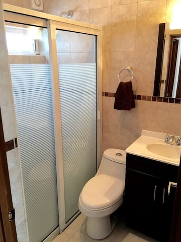 Bathroom with towels and Soap and Shampoo included