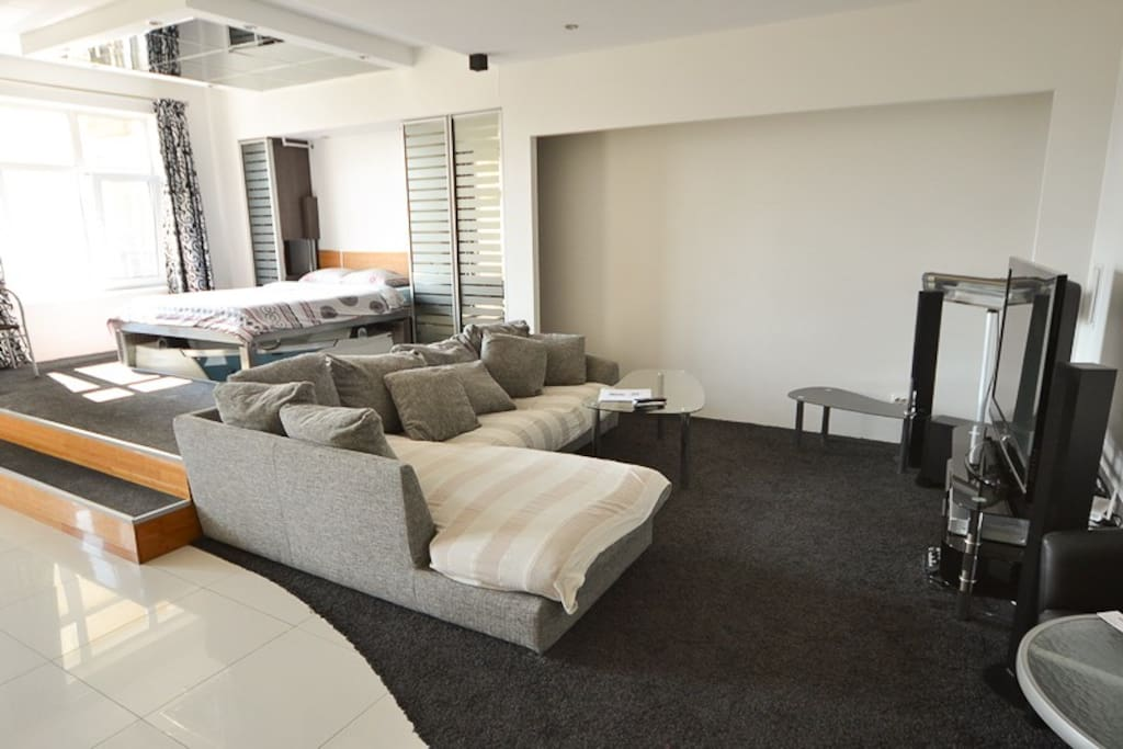 Living room zone with big sofa and LCD TV