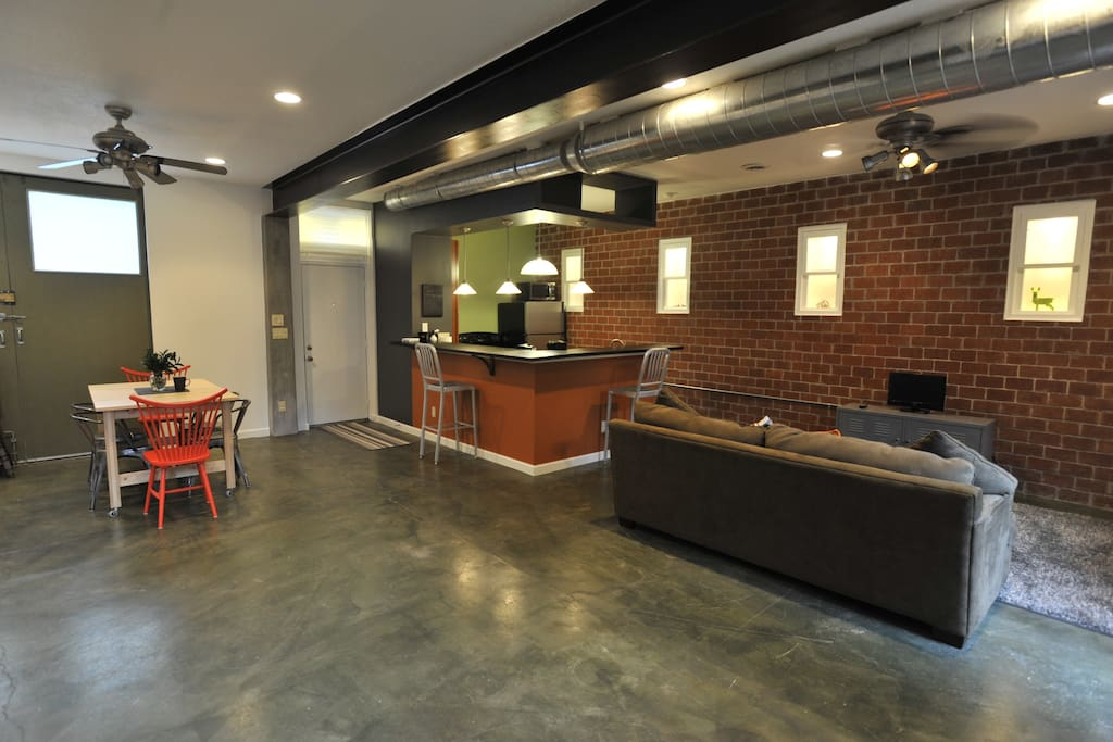 Terrific open floor plan with exposed brick