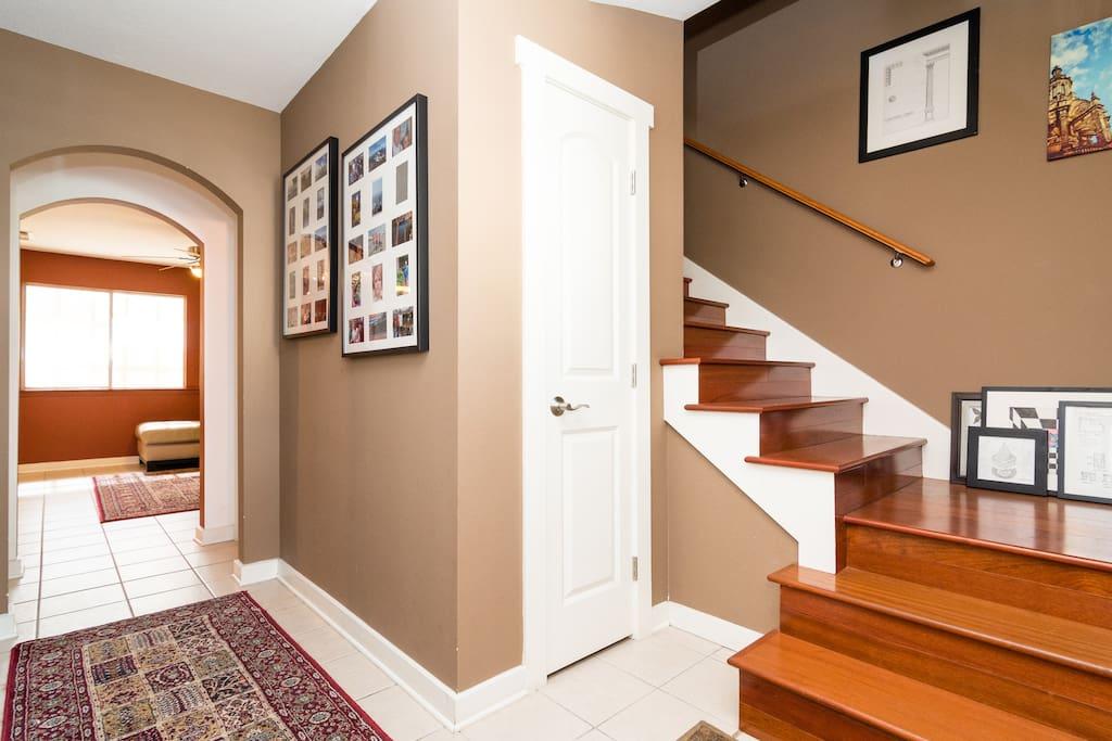 Brazilian Cherry hardwood floors, wool rugs, tile downstairs