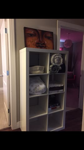 In between the guest room and your private sitting room with TV there is storage where you will find toiletries, extra blankets and board games!