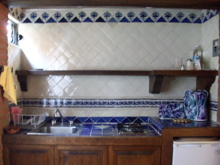 Fully equiped Kitchenette, with dishes, cooking pots, coffepot, toaster, fridge, stove