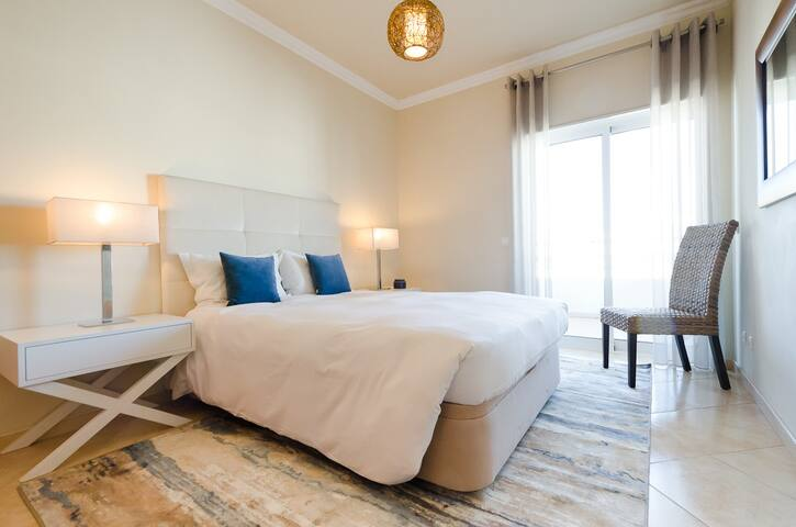 Double bedroom with a simple and comfortable feel with access to the terrace