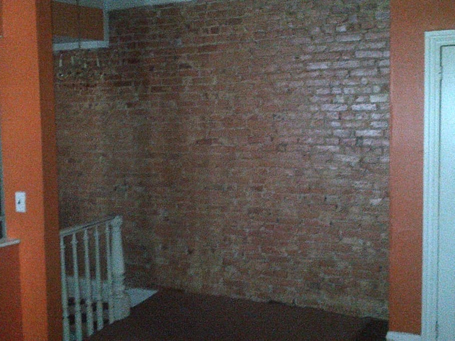 exposed brick wall with character of century old building