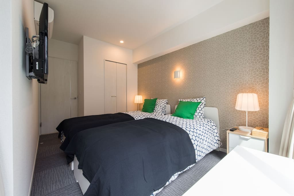 2 comfy single beds with natural light and TV