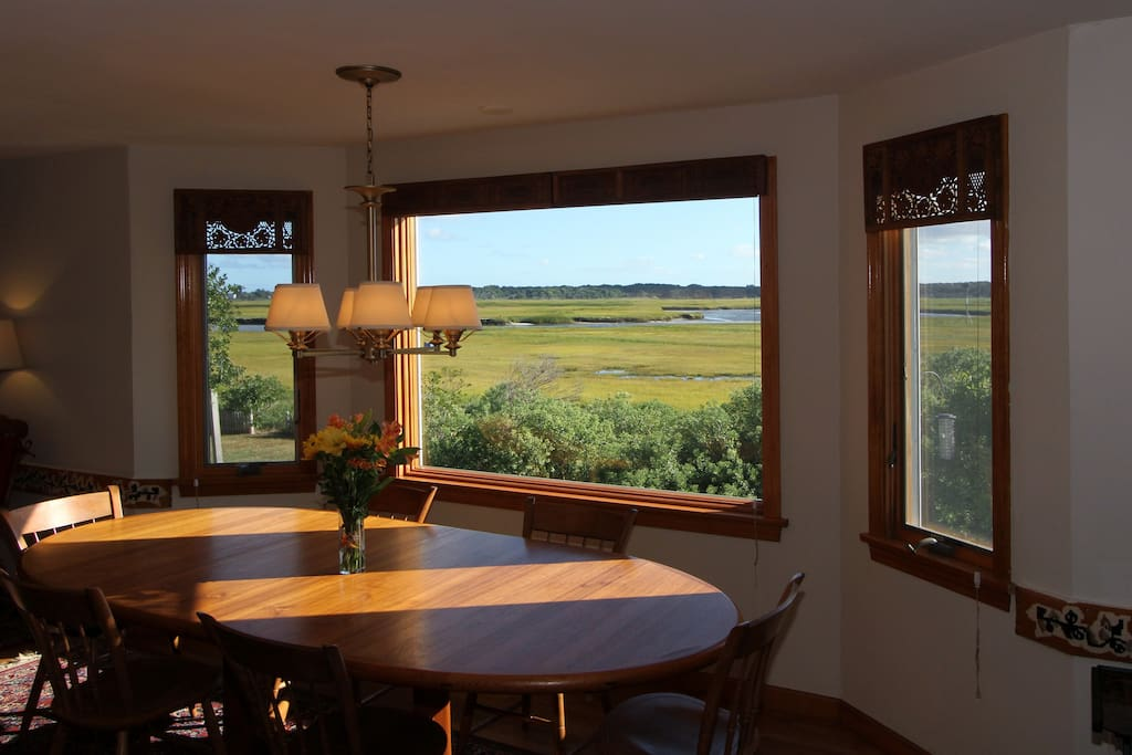 Big picture windows overlook the marsh in the dining room.