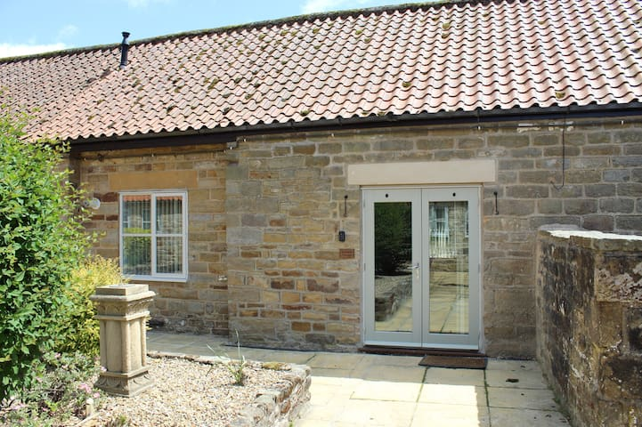 The rear courtyard entrance into River View Cottage