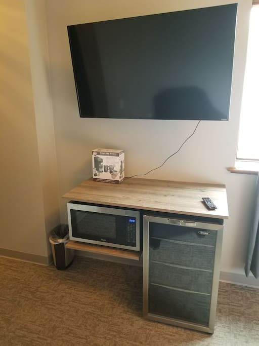 50 inch smart TV , microwave and mini fridge for your use.