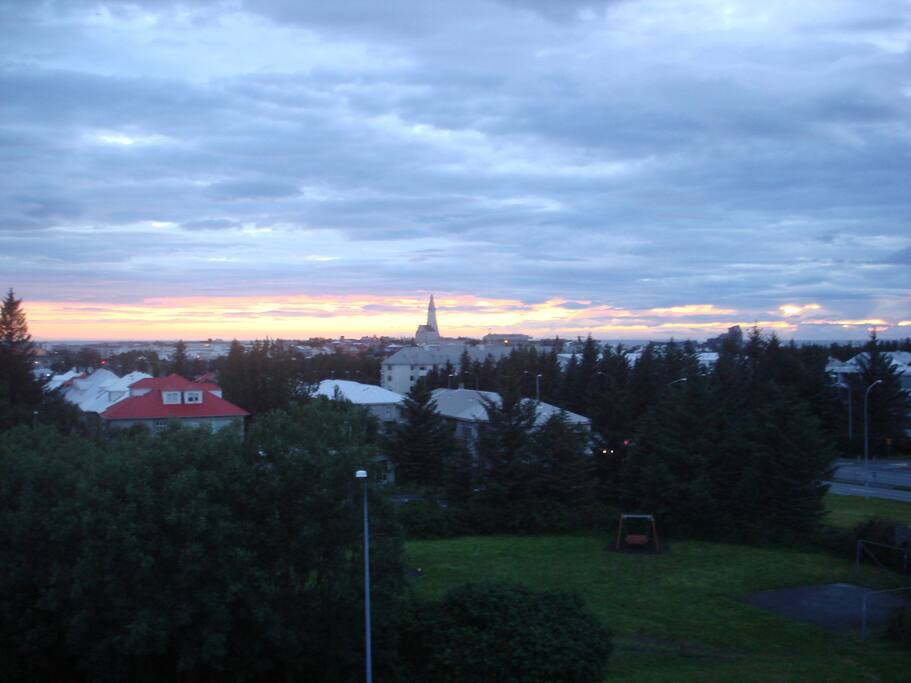 The view from the balcony over Reykjavik. Taken at midnight in june.