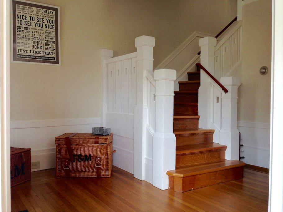 Spacious entrance hall and light filled Edwardian staircase.