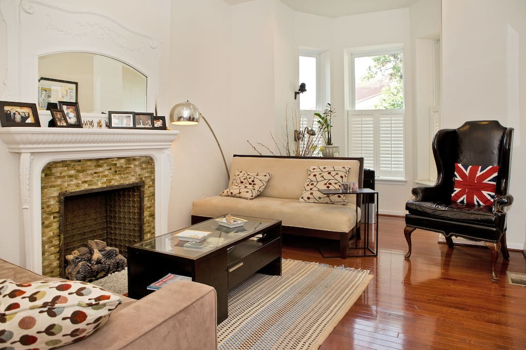 Living room with seating for 7 and antique fireplace. Overlooks historic Howard Theater. Double-paned windows hush all sounds from the street.