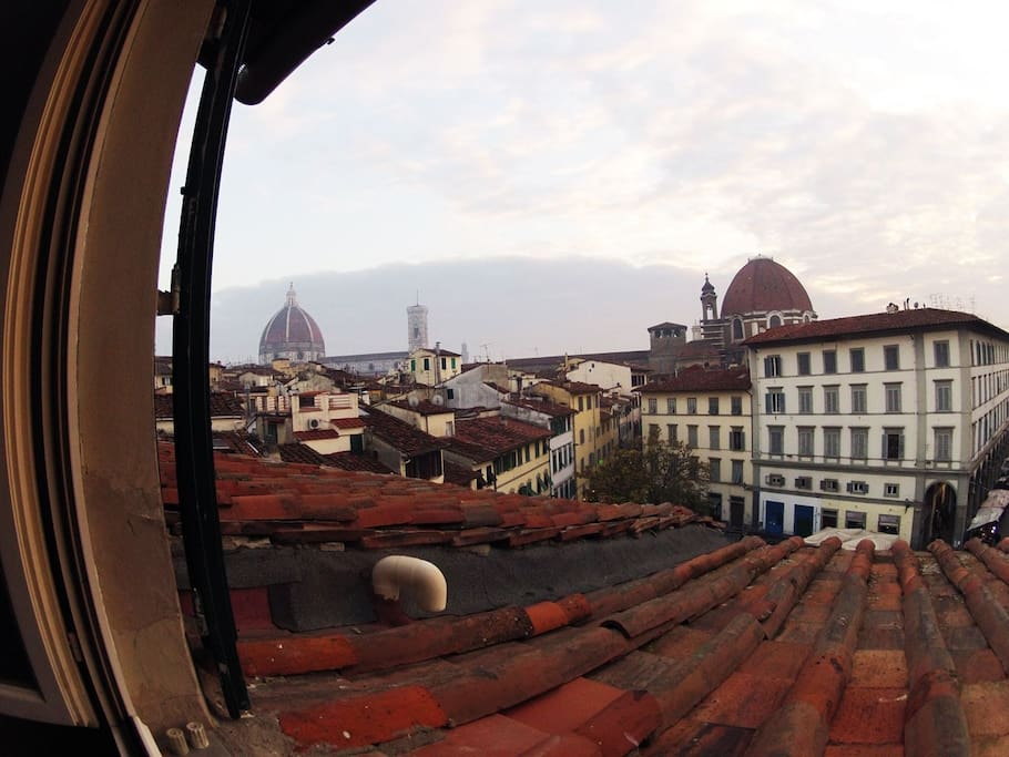 A view from the kitchen: the Duomo and the Medici Chapel over the market square.