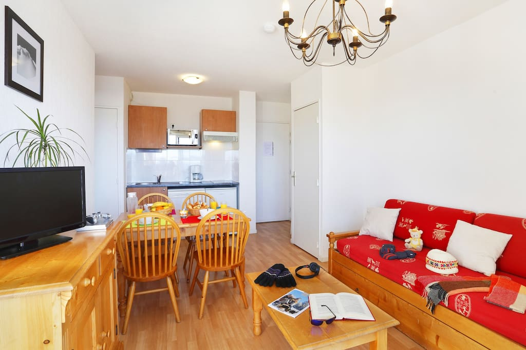 Prepare meals in the kitchenette and enjoy them at the dining table.