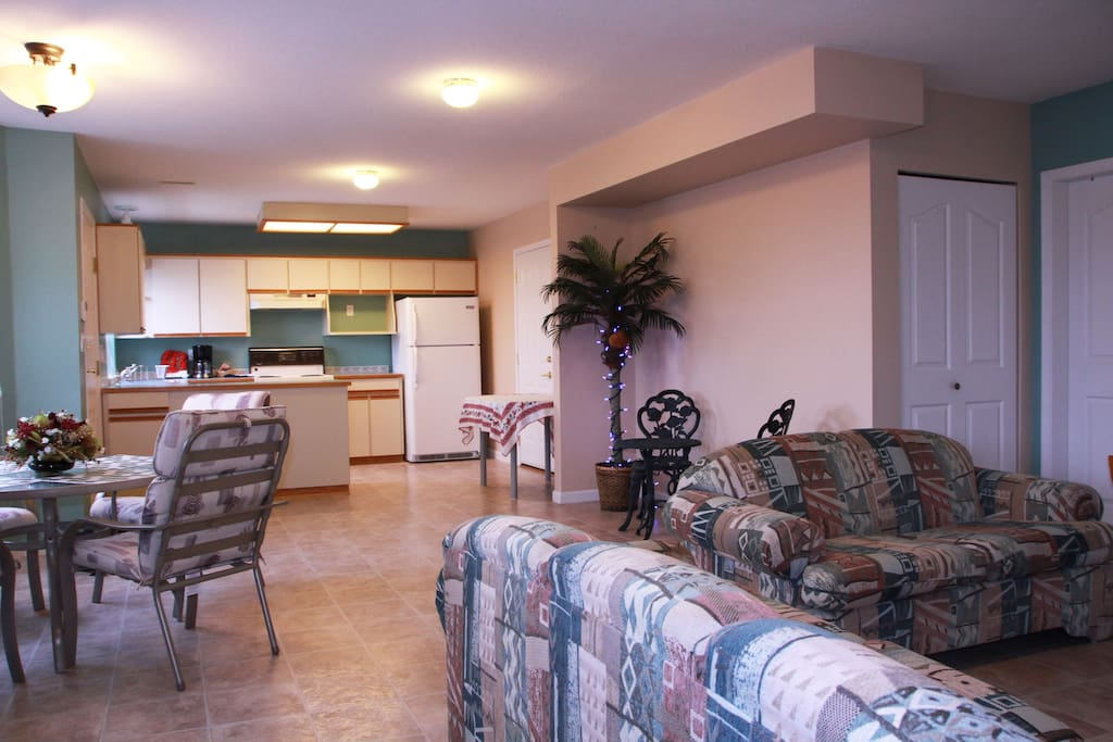 Bright and spacious living room with full size kitchen