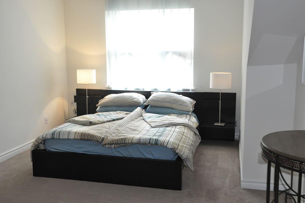 Second floor bedroom, queen sized memory foam mattress with duvet.