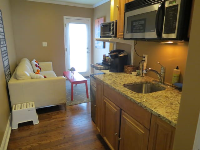 Small kitchenette with microwave, mini toaster oven, mini refrigerator and Keurig coffee machine with many drink choices!