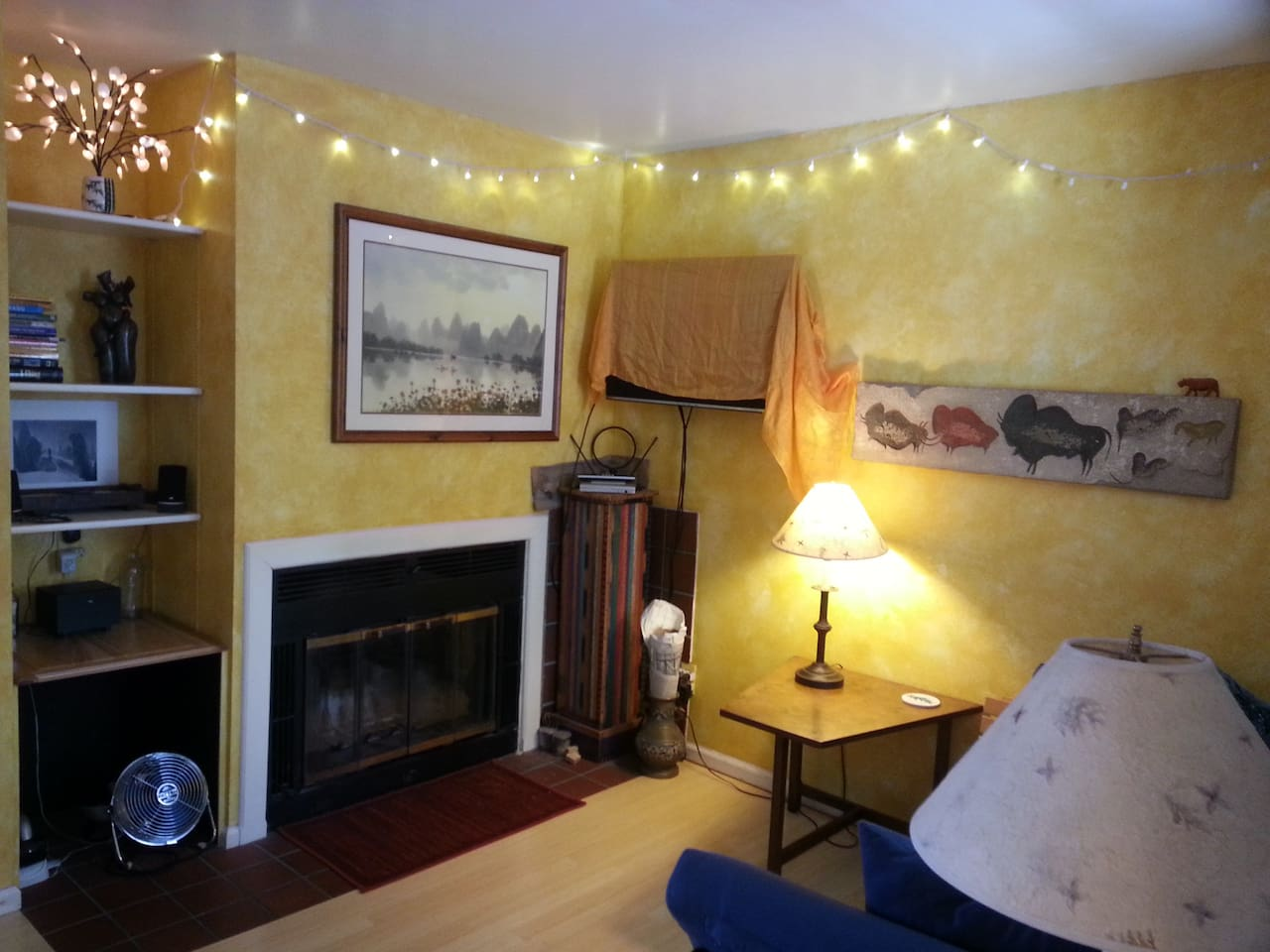 comfy living room with wood burning fireplace, MP3 system and TV/DVD