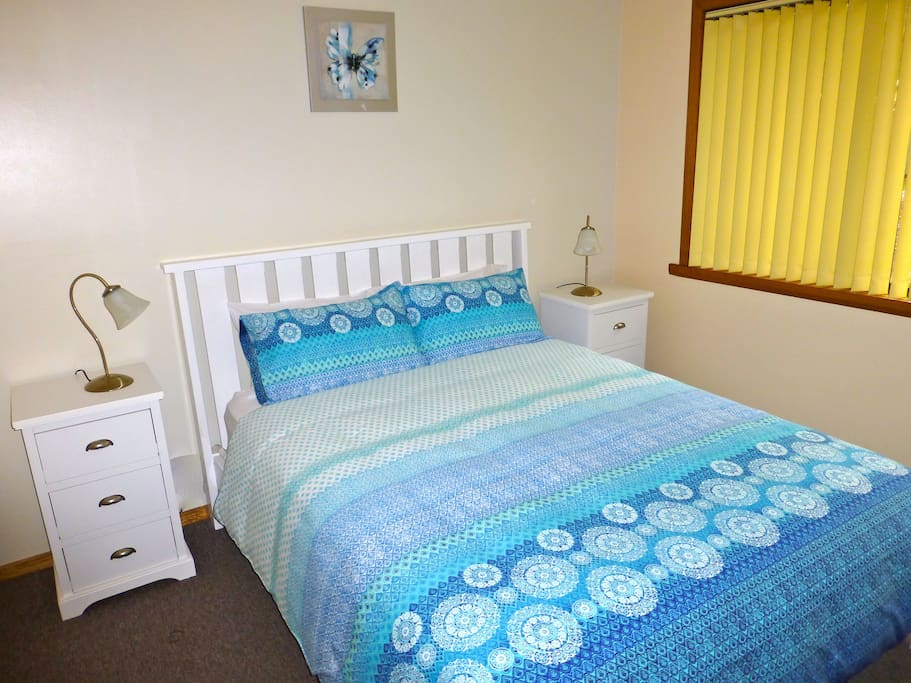 Main bedroom in Casuarina Cottage has a comfortable, queen sized bed.