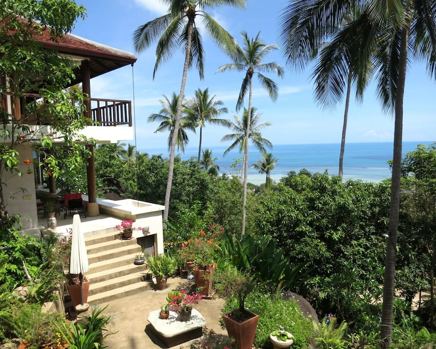 Frangipani villa garden and ocean view