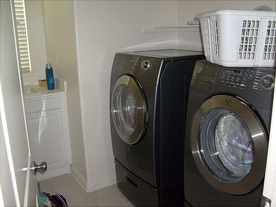 Laundry Room with huge front loaders.